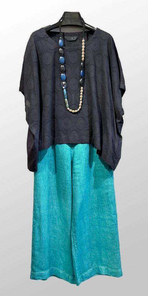 Moyuru dotted cotton boxy blouse, over Elemente Clemente wide-leg cropped linen pants.