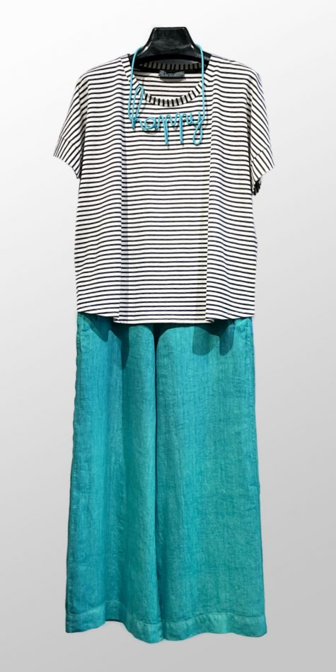 """Neirami Boxy short-sleeved stripe tee, over Elemente Clemente wide-leg cropped linen pants. Paired with a Samuel Coraux """"happy"""" necklace."""