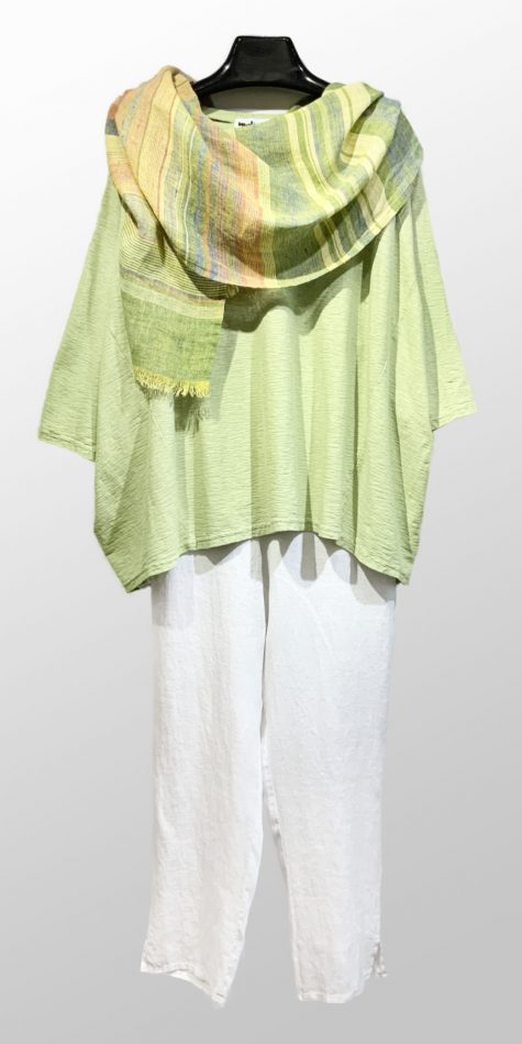 Motion boxy onesize pullover in asparagus green, paired with Flax ankle pants in white, and a Flax 100% linen striped scarf.