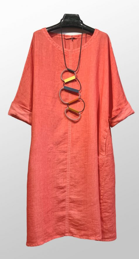 Elemente Clemente coral red linen dress, paired with a Christina Brampti ladder necklace.