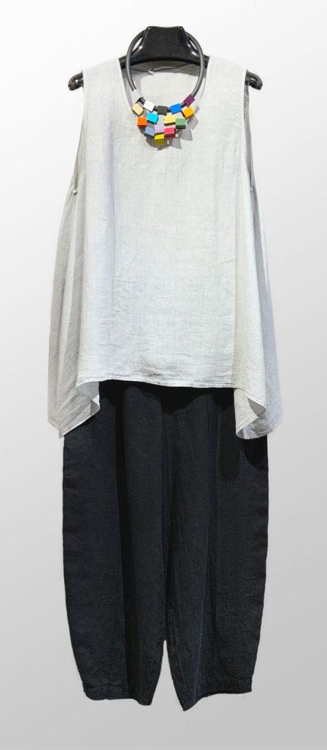 Elemente Clemente sleeveless linen blouse, over Elemente Clemente relaxed linen trousers.