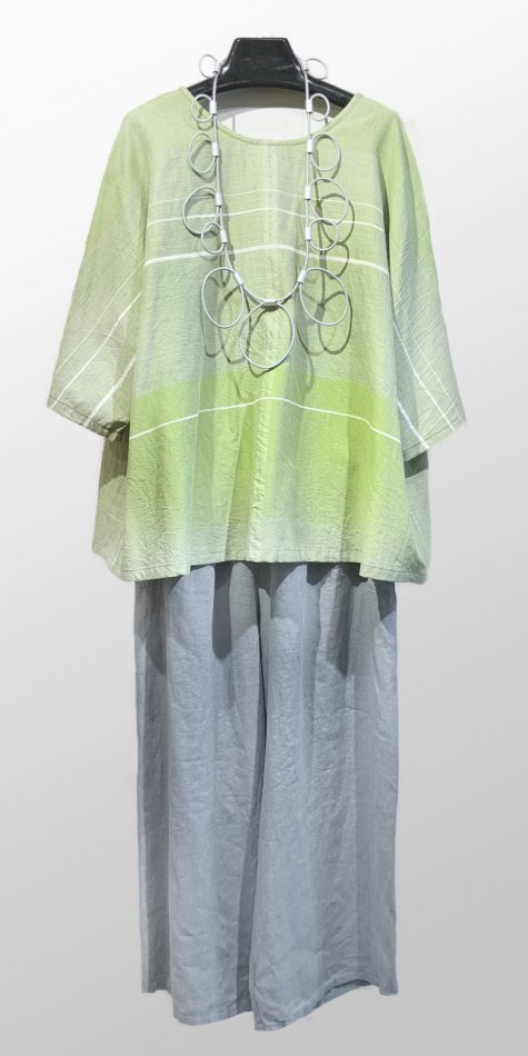 Tamaki Niime reversible 100% cotton blouse in pistachio greens. Worn with Neirami wide-leg linen pants, and paired with a Christine Brampti long necklace.