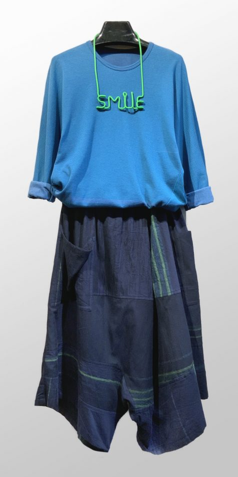 """Tamaki Niime dolman-sleeve 100% cotton tee, over Tamaki Niime 100% cotton drop-rise pants. Paired with a Samuel Coraux """"SMILE"""" necklace."""