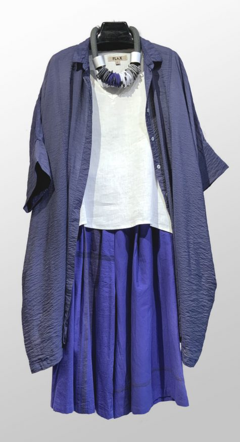 Motion onesize parachute shirtdress, over a Flax short-sleeve linen v-tee. Paired with Tamaki Niime cropped wide-leg pants. Finished with a Christina Brampti collar.