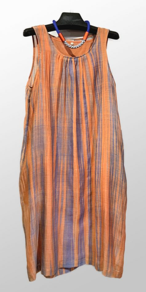Neeru Kumar hand-dyed silk dress with a cotton slip. Paired with a colorful Christina Brampti collar.
