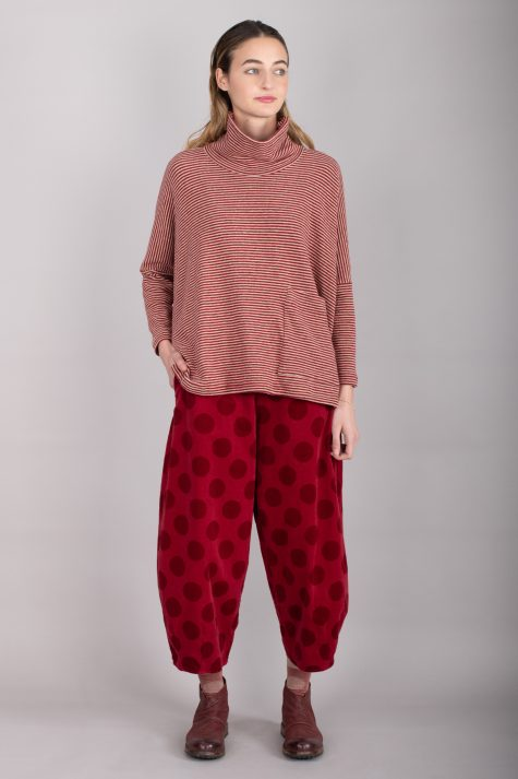 Mama B cozy knit boxy turtleneck, over Mama B relaxed corduroy pants with a dot print.