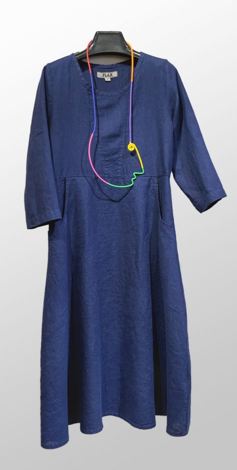 Flax 3/4 sleeve linen dress in midnight blue, paired with a colorful Samuel Coraux necklace.