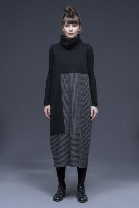 Neirami knit patchwork turtleneck bubble dress.