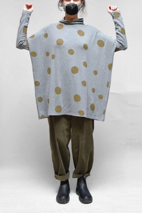 Neirami cozy knit boxy dotted turtleneck in grey with khaki dots. Layered over Oska corduroy pants in khaki green.