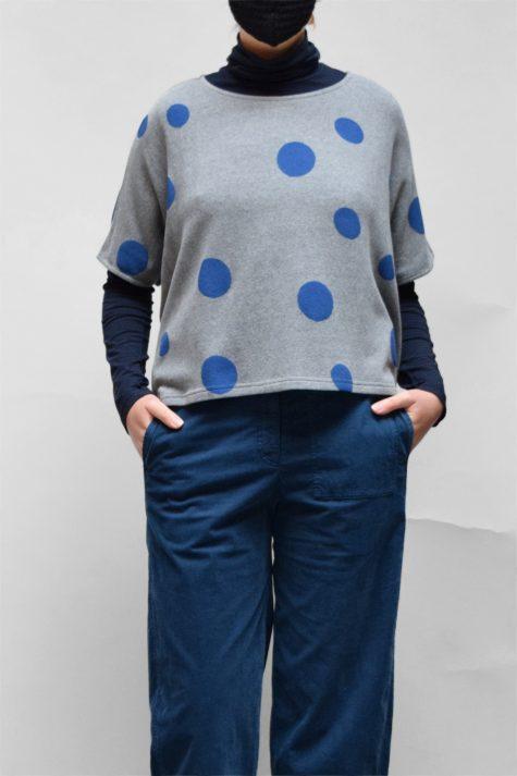 Neirami cozy knit boxy sweater vest, over a Mama B cotton knit turtleneck in navy blue.