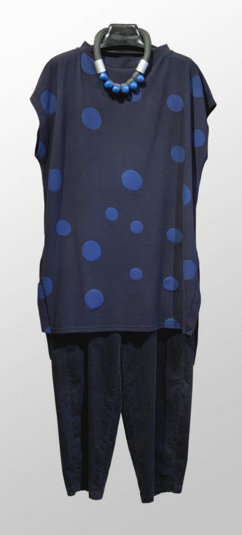 Neirami cozy knit long vest, over Oska corduroy trousers in black.