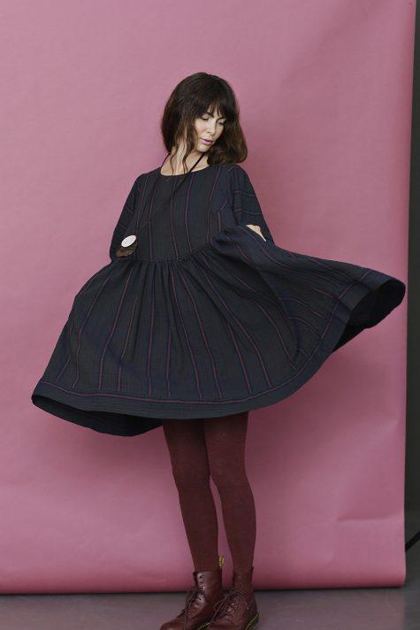 McVerdi shift dress with a full skirt and subtle stripe.