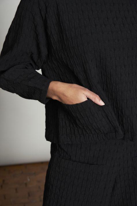 Elemente Clemente lantern-sleeve pullover in a medium-weight crepe, pocket detail.