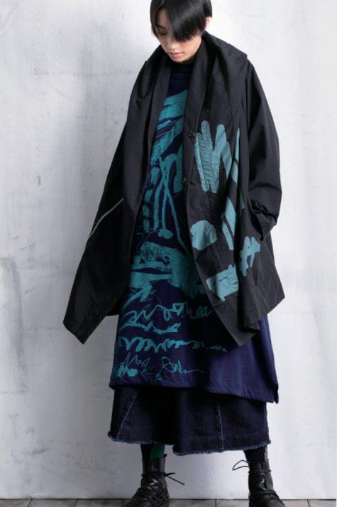 Moyuru printed nylon coat, over a Moyuru french terry printed dress, and Moyuru denim pants.