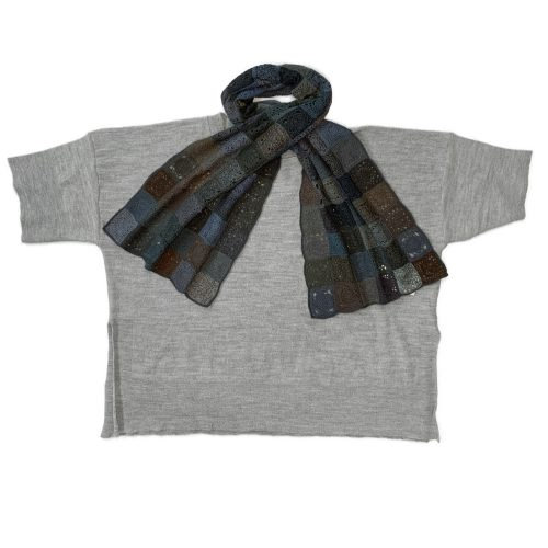 Oska boxy knit wool pullover, paired with a Sophie Digard hand-crocheted merino wool scarf.